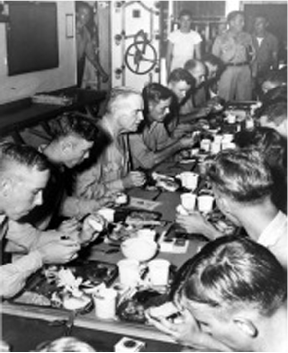 Adm. William F. Halsey, Jr., eats Thanksgiving dinner with the crew of USS New Jersey (BB 62), Nov. 30. 1944. Photo courtesy Naval History and Heritage Command