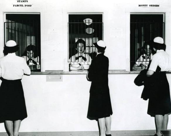 First Post office of its size in the US history entirely staffed by Women, at WAVES Quarters, Washington, D.C., three mail specialists on duty are, left to right, SPN3 Ruth Carter, SPM3 Patricia A. Campbell, and SPM3 Marion C. Eastman, June 1944. National Archives photograph, 80-G-457222.