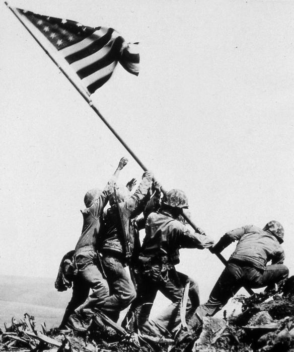 Raising the US Flag on Mount Suribachi. The Pulizer Prize winning photograph of the Iwo Jima Flag Raising was shot by AP Photographer Joe Rosenthal.