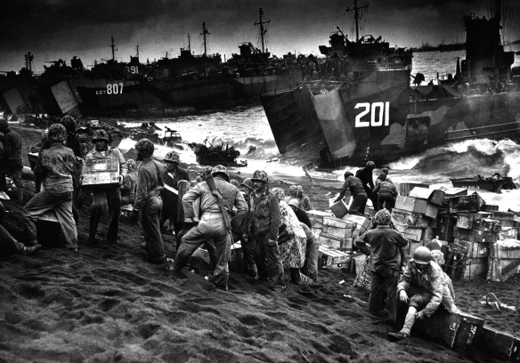 American supplies being landed at Iwo Jima  a few hours after the Marines had wrested their foothold on the vital island via the US Navy and Coast Guard.