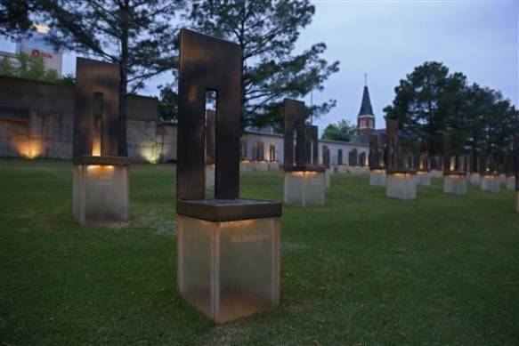 The chair dedicated to bombing victim Baylee Almon is pictured in the Field of Empty Chairs at the Oklahoma City National Memorial at dusk in Oklahoma City, Tuesday, April 14, 2015. Photo courtesy of SUE OGROCKI/AP