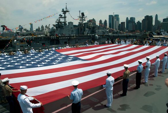 Honoring Their Own May 2011: U.S. Navy, United States Marine Corps and U.S. Coast Guard personnel unfurl an American flag on the flight deck of the Intrepid Sea, Air & Space Museum at a Memorial Day ceremony during Fleet Week New York. Fleet Week has been New York City's celebration of the sea services since 1984 and is an opportunity for citizens of New York and the surrounding area to meet Sailors, Marines and Coast Guardsmen and see firsthand the capabilities of today's maritime services.  Photo by Petty Officer 2nd Class Matthew R. White.