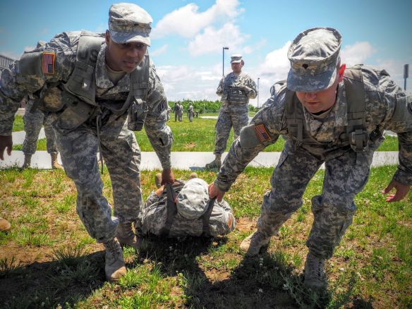 New York Army National Guard Specialists Kadeem Fowler, from Troy, N.Y., and Richard Madsen, from East Greenbush, N.Y., who are both members of the 42nd Infantry Division Headquarters and Headquarters Battalion, practice combat lifesaver techniques while at annual training June 16, 2015, at Fort Drum, N.Y.  Sgt. J.P. Lawrence/Army National Guard