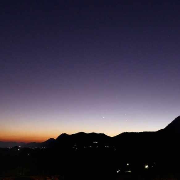 What will Venus look like before dawn? Here it is shortly before it slipping into the sunset in early August. This is Venus (brightest), Jupiter and Mercury low in the twilight on August 3, 2015. Photo by Peter Lowenstein in Mutare, Zimbabwe.